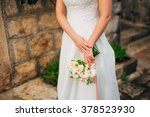 wedding bouquet in hands of the ... | Shutterstock . vector #378523930
