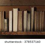 old books on wooden shelf. | Shutterstock . vector #378537160