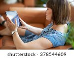 mature woman browsing the... | Shutterstock . vector #378544609
