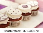 an ornate lilac cupcake on a... | Shutterstock . vector #378630370