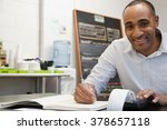 man doing accounts in cafe | Shutterstock . vector #378657118