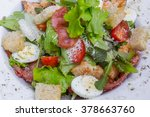 caesar salad with chicken and... | Shutterstock . vector #378663760