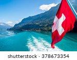 red  swiss flag over landscape...   Shutterstock . vector #378673354