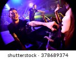 Small photo of HONG KONG - May 22, 2015: We Came As Romans show, Vocalist Kyle Pavone hanged microphone to the fan to sing along