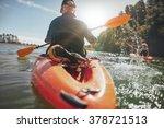 rear view of man paddling kayak ...   Shutterstock . vector #378721513