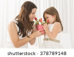 smiling mother getting flowers... | Shutterstock . vector #378789148