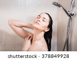 young woman washing her head... | Shutterstock . vector #378849928