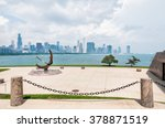Bronze sculpture located on the Lake Michigan lakefront outside the Adler Planetarium, as seen Chicago skyline blur in the background.