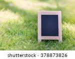 blank chalk board on grass... | Shutterstock . vector #378873826