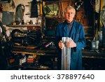 Senior Tinsmith In His Workshop.