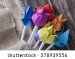 paper tulips on wooden table... | Shutterstock . vector #378939556