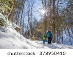 mother and son snowshoeing  | Shutterstock . vector #378950410