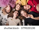 cheerful friends lying on the... | Shutterstock . vector #379020130