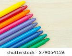 crayon on wood background | Shutterstock . vector #379054126