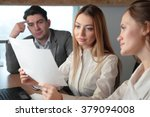 three people studying the paper ... | Shutterstock . vector #379094008
