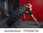 flipping tyre in gym | Shutterstock . vector #379206754