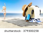 towel summer bag and bikini  | Shutterstock . vector #379300258