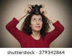 Woman Putting Slr Camera On To...