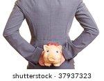 Businesswoman Hiding A Piggy...