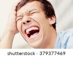 laughing out loud young man... | Shutterstock . vector #379377469