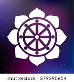 vector dharma wheel in lotus...