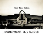 Small photo of Find Your Voice message typed on vintage typewriter