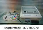 Small photo of HUIS TEN BOSCH, JAPAN - September 4 2014: A Super nintendo video game device displays in game museum in Huis Ten Bosch. The famous 16-bit entertainment system sold worldwide during the 1990's.