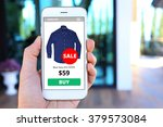 hand holding smartphone with... | Shutterstock . vector #379573084