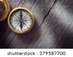 Antique Golden Compass On Wood...