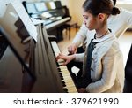 a music teacher with the pupil... | Shutterstock . vector #379621990