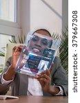 businesswoman using tablet... | Shutterstock . vector #379667308