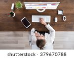 young businesswoman looking at... | Shutterstock . vector #379670788