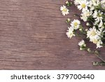 Flowers On Wooden Background....