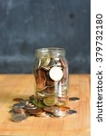 money or coins in a full jar... | Shutterstock . vector #379732180