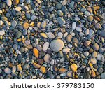 Pebbles On The Beach As...