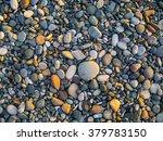 Pebbles On The Beach As...