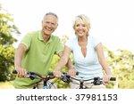 mature couple riding bikes   Shutterstock . vector #37981153