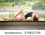 young woman is practicing yoga  | Shutterstock . vector #379822750