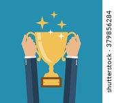 winning cup in his hands.... | Shutterstock .eps vector #379856284
