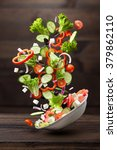 flying salad isolated on wooden ... | Shutterstock . vector #379862110