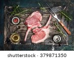 raw pork cutlet with oil and... | Shutterstock . vector #379871350