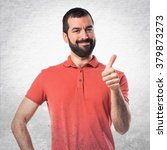 handsome man with thumb up | Shutterstock . vector #379873273
