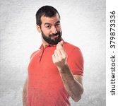 handsome man doing a money... | Shutterstock . vector #379873336