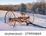 An Old Hay Rake In Fresh Snow ...