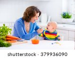 mother feeding child. first... | Shutterstock . vector #379936090
