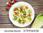 fresh healthy salad on wooden... | Shutterstock . vector #379956928