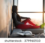 a woman in a red sport pants... | Shutterstock . vector #379960510