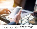 smart phone in businessman hand ... | Shutterstock . vector #379962580
