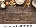 flour in a wooden bowl on dark... | Shutterstock . vector #379999999