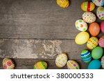 easter eggs on wooden background | Shutterstock . vector #380000533